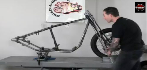 strapped frame on motorcycle table lift