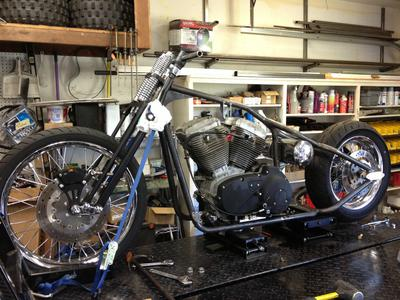 Bobber with engine and transmission set in the frame